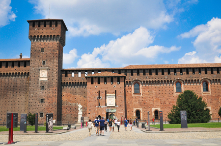 sforza: Milan, Italy - June 27, 2016: Tourists visit the XV century Sforza Castle (Castello Sforzesco) in Milan, Lombardy, Italy