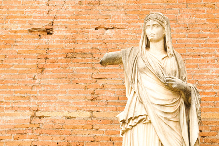Detal of ancient statue in Rome, Italy