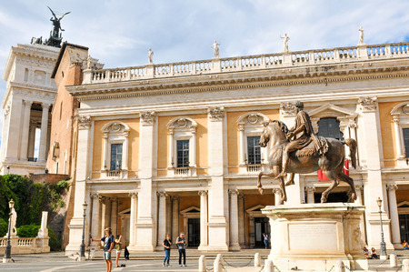 Rome, Italy - June 20, 2016: Tourists visit the Capitoline Hill Museum guarded by a replica of the equestrian statue of Marcus Aurelius in Rome, Italy. Editorial