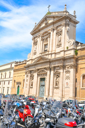 Rome, Italy - June 20, 2016: Various scooters are parked in front of a historic building in Rome. Rome is ranked among the cities with the most registered scooters in the world.