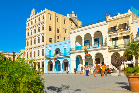 Havana, Cuba - December 19, 2016: Tourists admire old architecture in Plaza Vieja (Old Square), one of the four main squares in Havana, Cuba