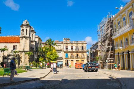 Havana, Cuba - December 19, 2016: Tourists visit old buildings in Habana Vieja (Old Havana) square in Havana, Cuba Editorial