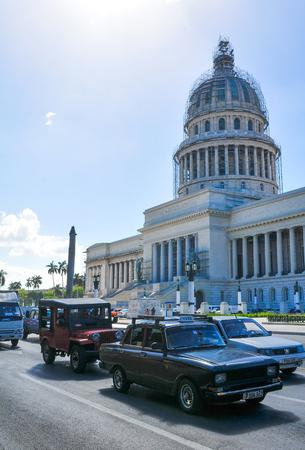 Havana, Cuba - December 19, 2016: Retro cars pass the Capitol building (El Capitolio) in the heart of Habana Vieja (Old Havana) in Cuba Editorial