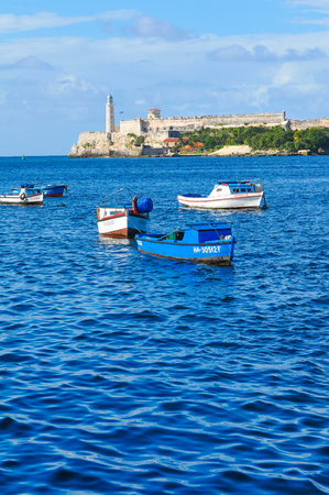 Havana, Cuba - December 19, 2016: Colourful fishing boats are anchored in Havana Bay, Cuba