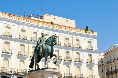 plaza of arms: Equestrian statue in  Puerta del Sol square in Madrid, Spain