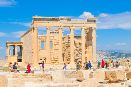restored: Athens, Greece - June 12, 2017: Tourists visit the Parthenon, a former temple dedicated to the goddess Athena and famous landmark in Athens, Greece