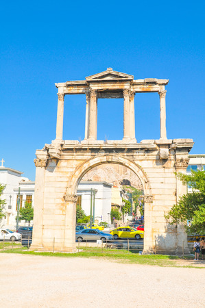 Athens, Greece - June 13, 2017: Tourists visit the Arch of Hadrian, a major historic landmark in Athens, Greece