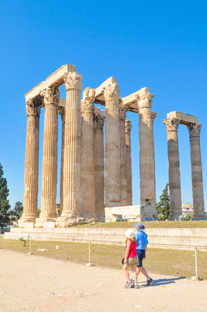 olympus: Athens, Greece - June 13, 2017: Tourists visit the Temple of Olympian Zeus, a major historic landmark in Athens, Greece Editorial
