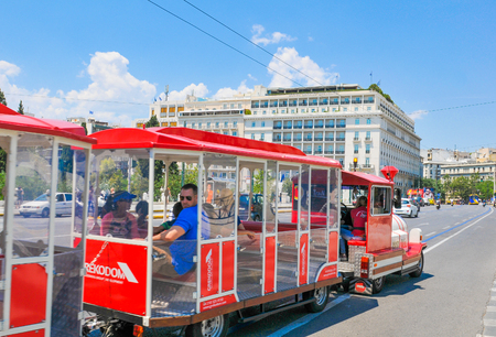 Athens, Greece - June 14, 2017: Tourists sightseeing from a mini-train in Syntagma Square, Athens, Greece