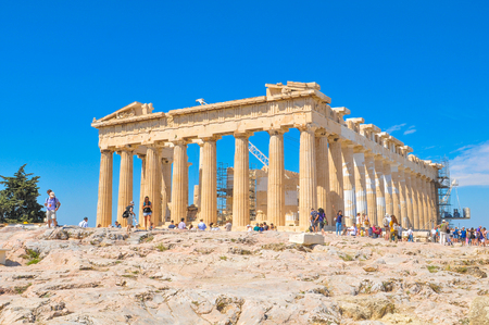 restore: Athens, Greece - June 12, 2017: Tourists visit the Parthenon, a former temple dedicated to the goddess Athena and famous landmark in Athens, Greece