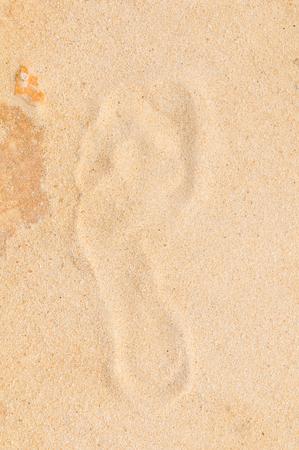 Close up of human footprint on sand