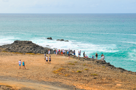 Tourists visit the volcanic beach on the island of Boa Vista, Cape Verde, Africa