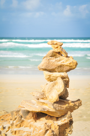 Meditation concept with detail of balanced rocks at the beach