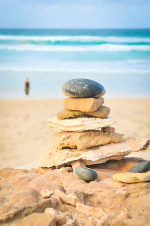 Balance your life, meditation, mindfulness, or zen concept with stones piled up by the sea
