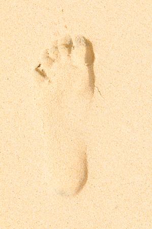 Detail of a footprint on the beach