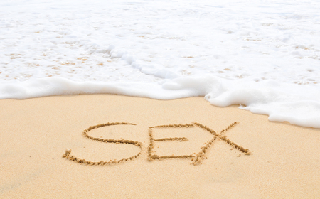 Sex written on the sand of an exotic beach Stock Photo