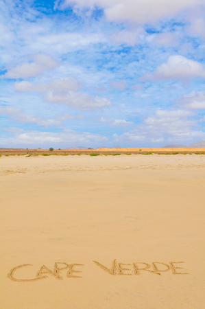 Visit Cape Verde concept written on the sand of a beach in Boa Vista