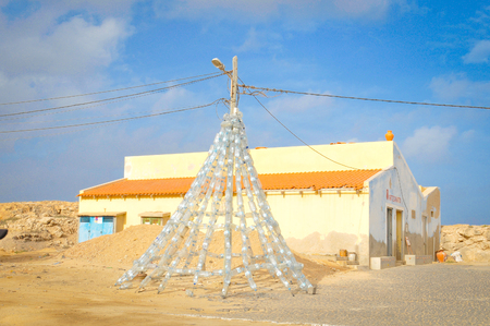 Boa Vista, Cape Verde - December 20, 2017: View of a Christmas tree created from recycled plastic bottles in Rabil on the island of Boa Vista, Cape Verde, Africa