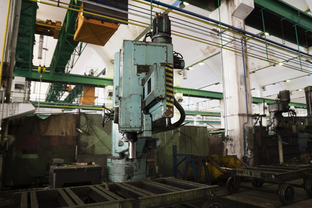 big drilling-machine in an old factory photo