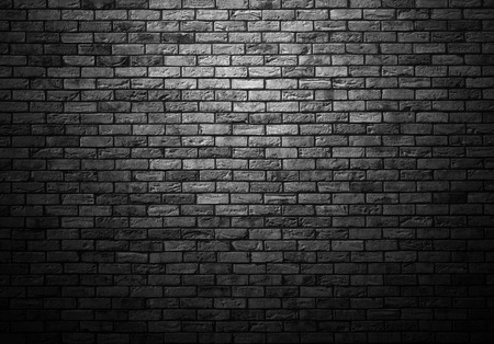 dimly: dimly lit old brick gray wall with ligth vignette