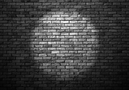 dimly: dimly lit old brick wall enlightened cone of light