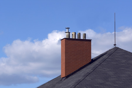 new renovated brick chimney on the house