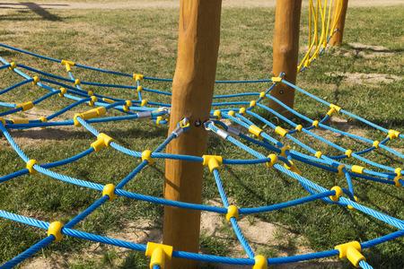 climbing frame: Rope climbing frame in the shape of cobwebs on the playground