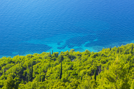 azure coast: view of the azure sea coast with forest Stock Photo