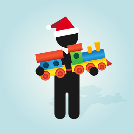 christmas train: figure man with santa hat holds childrens color toy train with carriages