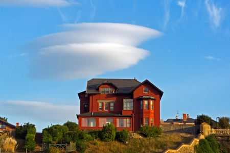 lenticular: A mansion in Getxo with a lenticular cloud Stock Photo