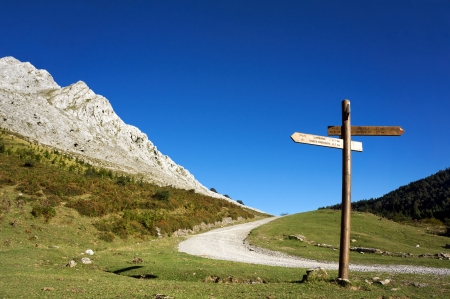 signpost in the mountain with blue sky photo