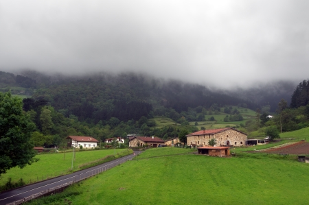 Basque country village with typically basque houses and rainy weather  Taken in Axpe, Atxondo, Basque Country, Spain