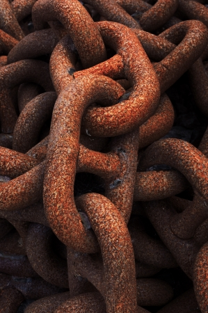 closeup of metallic and rusty chains photo