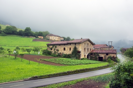 typical basque architecture near a road Editorial