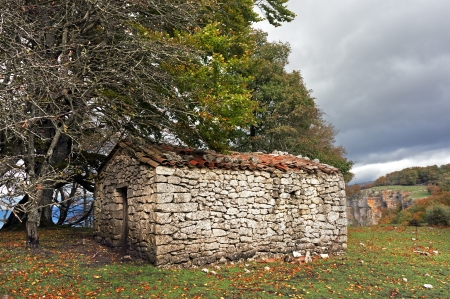 Stone Cabin In Mountain Near A Forest Photo