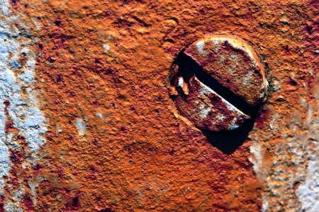 screw head in a grungy wall Stok Fotoğraf