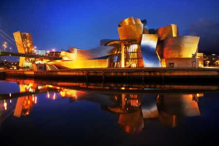 frank gehry: BILBAO, SPAIN - JULY 15: Guggenheim Museum on July 15, 2012 in Bilbao, Spain. The Guggenheim Museum is a dedicated exhibition of modern art and was designed by architect Frank Gehry