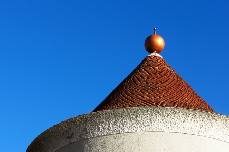 house roof and dome against blue sky photo