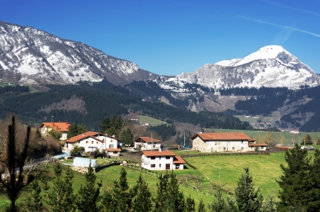 village in Aramaio valley, surrounding by snowy mountains, in Basque Country. photo