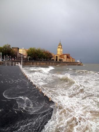 Gijon promenade under storm with rough sea Stock Photo