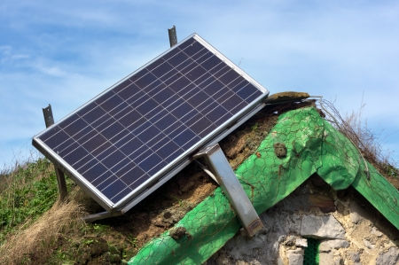 solar panel on old cabin roof photo