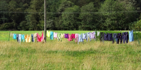 oudoors: laundry clothes hanging oudoors and drying with rope and clothespins