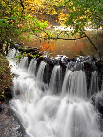 small cascade in water stream photo