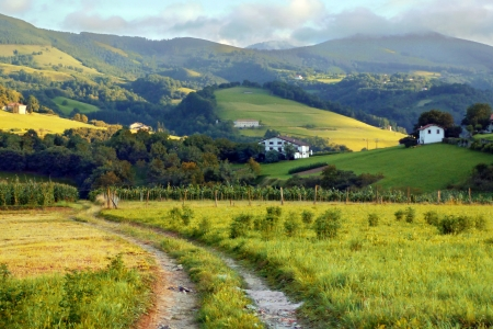 basque country: basque country village with fields and orchards