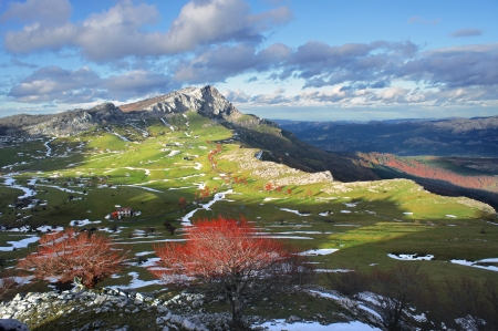thaw in Arraba meadows surrounding by mountains in Gorbea. Basque Country, Spain Standard-Bild