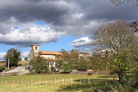 rural landscape with village on countryside with church. Alava, Basque Country, Spain photo