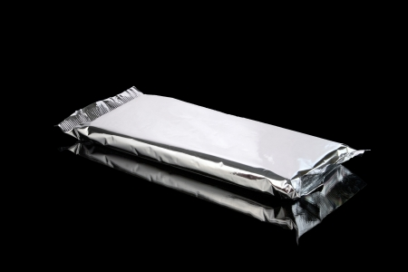 Foil aluminum bag closed isolated on black  photo