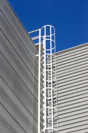 safety ladder on industrial facade photo