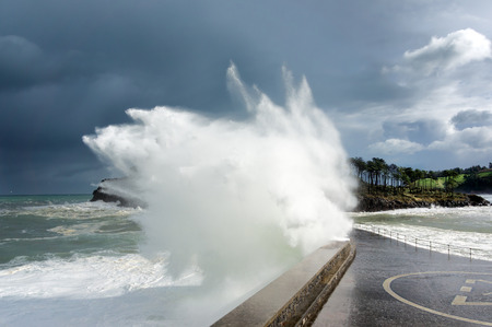 stormy weather on sea with big wave breaking on breakwater Standard-Bild