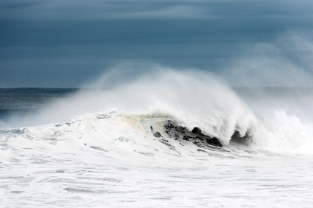 stormy weather on rough sea with big wave breaking photo